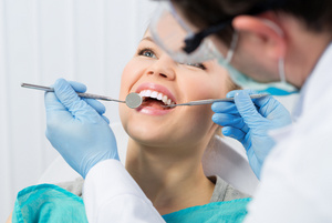 Dr. Grubb will examine your mouth for signs of oral cancer.